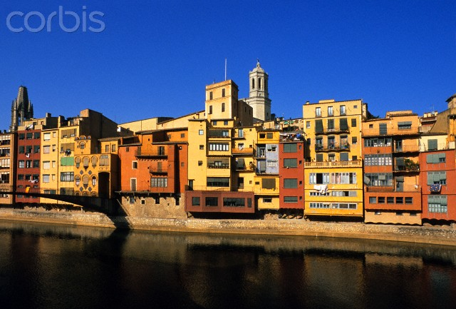 Spain, Catalonia, Girona Province, Girones comarca, Girona, colored facades and cathedral above the waters of Onya River