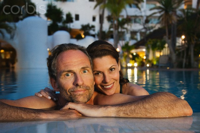 Portrait of couple relaxing in hotel pool