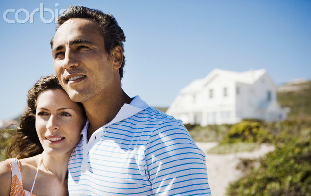 Couple in Front of a Beach House