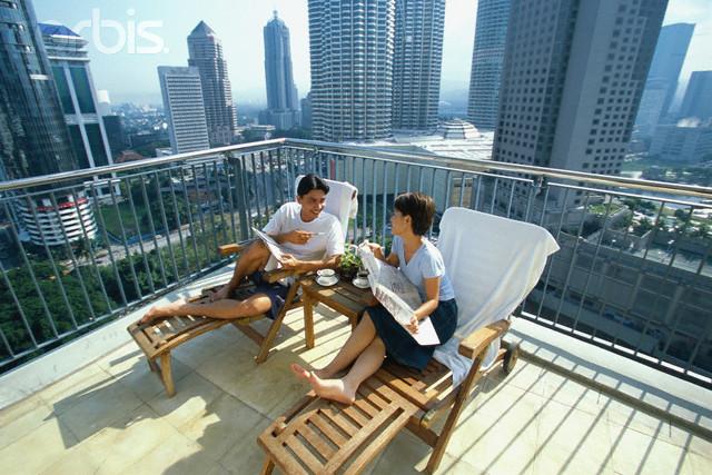 Couple Reading on Balcony